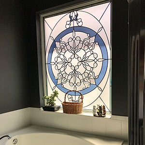 Stained glass rose bathroom window