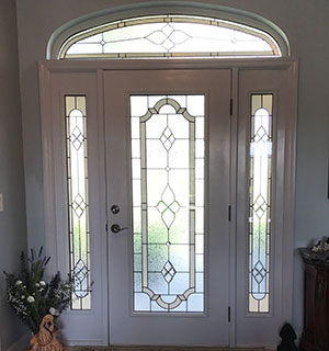 Entry way door, sidelights and transom in traditional stained glass style