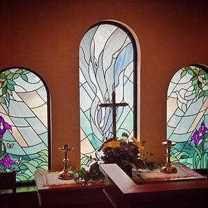 Stained glass behind altar in Cornerstone Hospice, The Villages