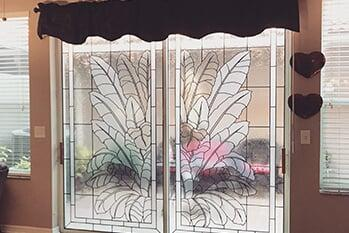 Patio sliding door tropical leaf design