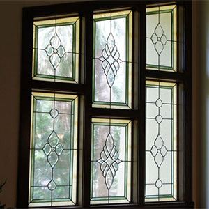 Oversized transom in period style bevelled colored glass